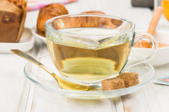 Infusion of green tea in wood. Infusion of green tea in white wood stock images