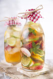Infusion of tea peach and lemon Stock Photos