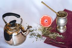 Infusion of Yerba mate with grapefruit and teapot royalty free stock image