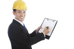 Ingénieur asiatique avec des écritures Images stock