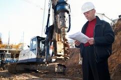 Ingénieur au chantier de construction images stock