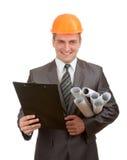 Ingénieur avec les plans et la planchette image stock
