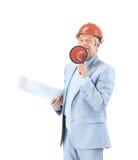 Ingénieur dans le casque antichoc avec un mégaphone et dessins sur un fond blanc Images stock