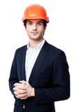Ingénieur dans le casque antichoc d'isolement sur le blanc Images stock