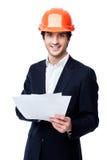 Ingénieur dans le casque antichoc d'isolement sur le blanc Photos libres de droits