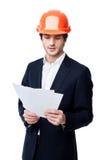 Ingénieur dans le casque antichoc d'isolement sur le blanc Photos stock