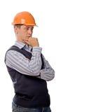 Ingénieur dans penser orange de casque Image libre de droits