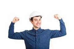 Ingénieur puissant montrant des muscles images libres de droits