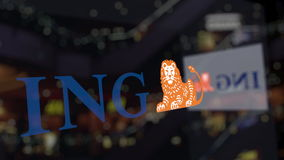 ING Group logo on the glass against blurred business center. Editorial 3D rendering Royalty Free Stock Photography