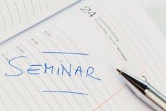 Ingang in de kalender: seminarie Stock Afbeeldingen
