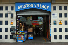 Ingang en Teken, Brixton Village, Zuid-Londen, Engeland stock foto