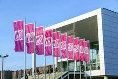 Ingang en vlaggen van ISM in Keulen Stock Afbeeldingen