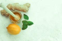 ingefära, citron och honung arkivfoto