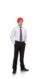 Ingegnere dell'uomo in un casco rosso fotografia stock libera da diritti