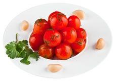 Ingelegde tomaten in witte plaat Royalty-vrije Stock Fotografie