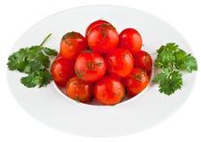Ingelegde tomaten in witte plaat Royalty-vrije Stock Foto's