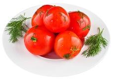 Ingelegde tomaten in witte plaat Stock Fotografie
