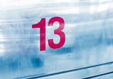Ingen 13 på metallbakgrund Fotografering för Bildbyråer