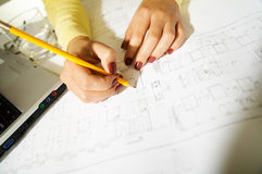 Ingeneer at work, blueprints Royalty Free Stock Photo