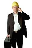Ingeniero con el teléfono celular fotografía de archivo libre de regalías
