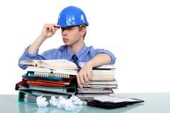 Ingeniero con exceso de trabajo Fotografía de archivo