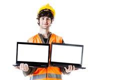 Ingeniero con los ordenadores portátiles fotos de archivo