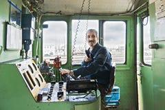 Ingeniero locomotor en cabina Foto de archivo