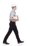 Ingeniero que camina Imagen de archivo libre de regalías