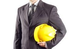 Ingeniero que sostiene un casco Imagenes de archivo