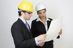 Ingeniero y cliente en sitio Foto de archivo libre de regalías