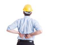Ingenieur of architect die lagere rugpijn voelen Stock Foto