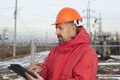 Ingenieur bij Elektrohulpkantoor De elektromachtsindustrie Stock Afbeelding