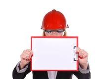 Ingenieur, der Klemmbrett hält Stockfotos