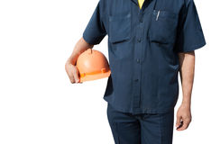 Ingenieur, der orange Sturzhelm für Arbeitskraftsicherheit hält Lizenzfreie Stockfotos
