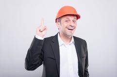 Ingenieur die bouwvakker dragen die goed ideegebaar maken Stock Afbeelding