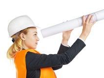 Ingenieur-Frau mit Zeichnung Lizenzfreie Stockfotografie