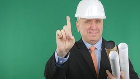 Ingenieur Image Smiling And, das mit dem Finger oben zeigt stockfotos