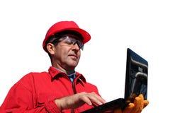 Ingenieur With Laptop Computer over een Witte Achtergrond wordt geïsoleerd die Stock Foto