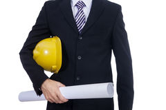 Ingenieur mit gelbem Sturzhelm- und Papierplan Stockbild