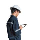 Ingenieur of Technicus in witte helm, glazen en het blauwe werken Royalty-vrije Stock Foto's