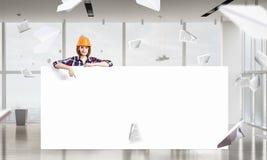 Ingenieursvrouw met banner Royalty-vrije Stock Afbeeldingen