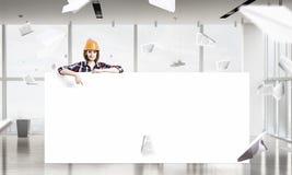 Ingenieursvrouw met banner Royalty-vrije Stock Foto's