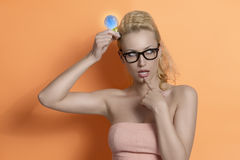 Ingenious girl having an idea with a clean energy light Royalty Free Stock Photos