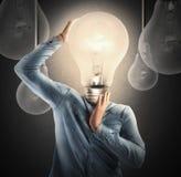 Ingenious head. Man with a light bulb as head Stock Image