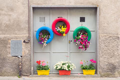 Ingenious, original and environmentally friendly method of recycling of tires car as planters in a village in Tuscany Stock Images