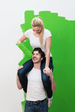 Ingenious young couple solve a problem painting Royalty Free Stock Images