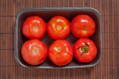 Ingepakte tomaten Stock Afbeeldingen
