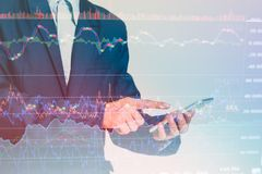 Inger touching smart phone with finance and banking profit graph of stock. Double exposure Businessman finger touching smart phone with finance and banking Stock Photos