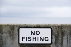 Inget fisketecken på beskydd för havshamnhamn royaltyfri bild