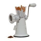 Inget - röka bild med cigaretter i en köttkvarn Arkivfoton